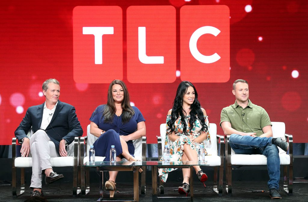90 Day Fiance panel in front of a TLC logo