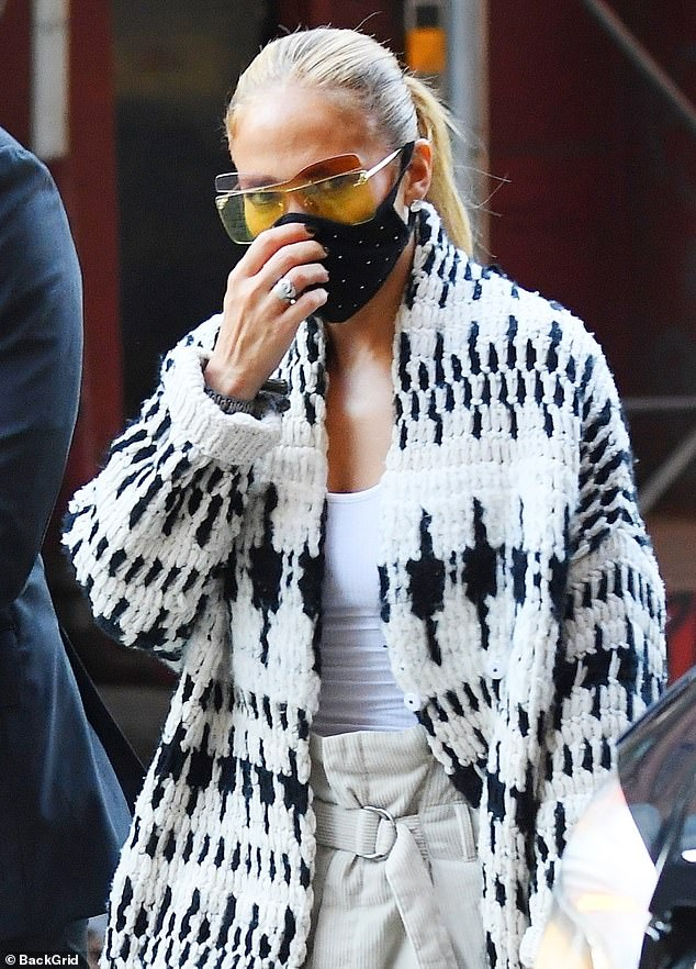 Eye-catching: The 5ft5in beauty wore her bleached blonde locks in a ponytail, and she resembled butterfly wings with a large pair of yellow sunglasses.
