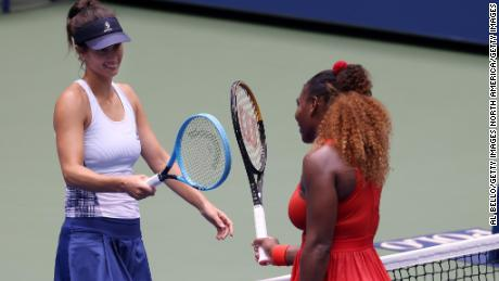 Serena Williams, right, and Svetlana Frankova exchange a smile as the US Open quarterfinals draw to a close.