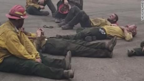 Exhausted firefighters sing together after a 14-hour shift to fight wildfires in Oregon