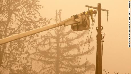 Workers continue to repair the electrical system following a fire from a Peachy Creek fire through a Fishermen's Bend entertainment site in Mill City, Oregon.