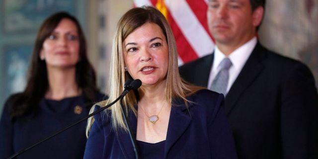 Judge Barbara Lagova speaks at the center, Florida Gov. Ron Desantis and Lt. Gen. Janet Nunes, left, January 9, 2019, in Miami.  (Associated Press)