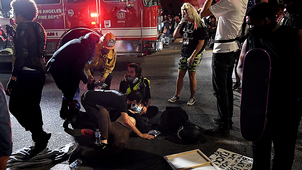 LA police detain and release driver after plowing vehicle on protesters;  At least 1 injury: report