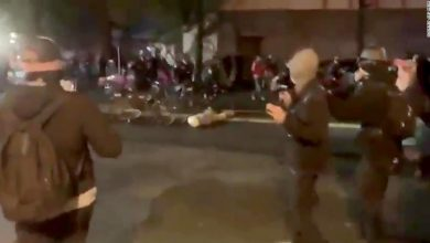 Photo of Seattle police officer caught on video riding a bicycle over the head of a protester on administrative leave