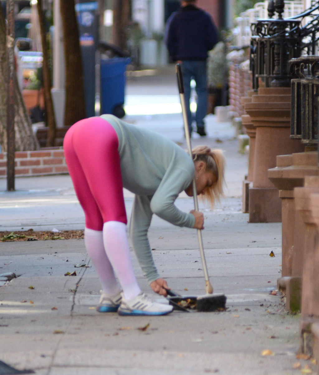 EXCLUSIVE: Busy Phillips clears some leaves in New York City.