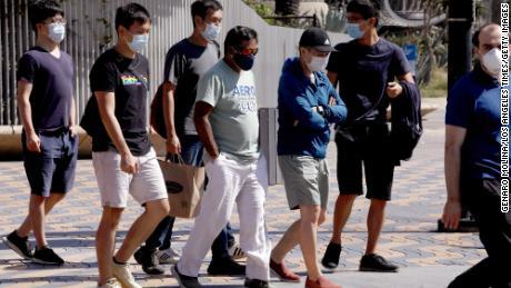 Pedestrians wear masks on their way to Santa Monica on September 29th.