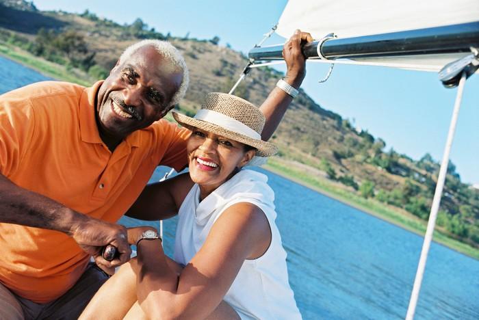 A happy senior couple travels on a lake.
