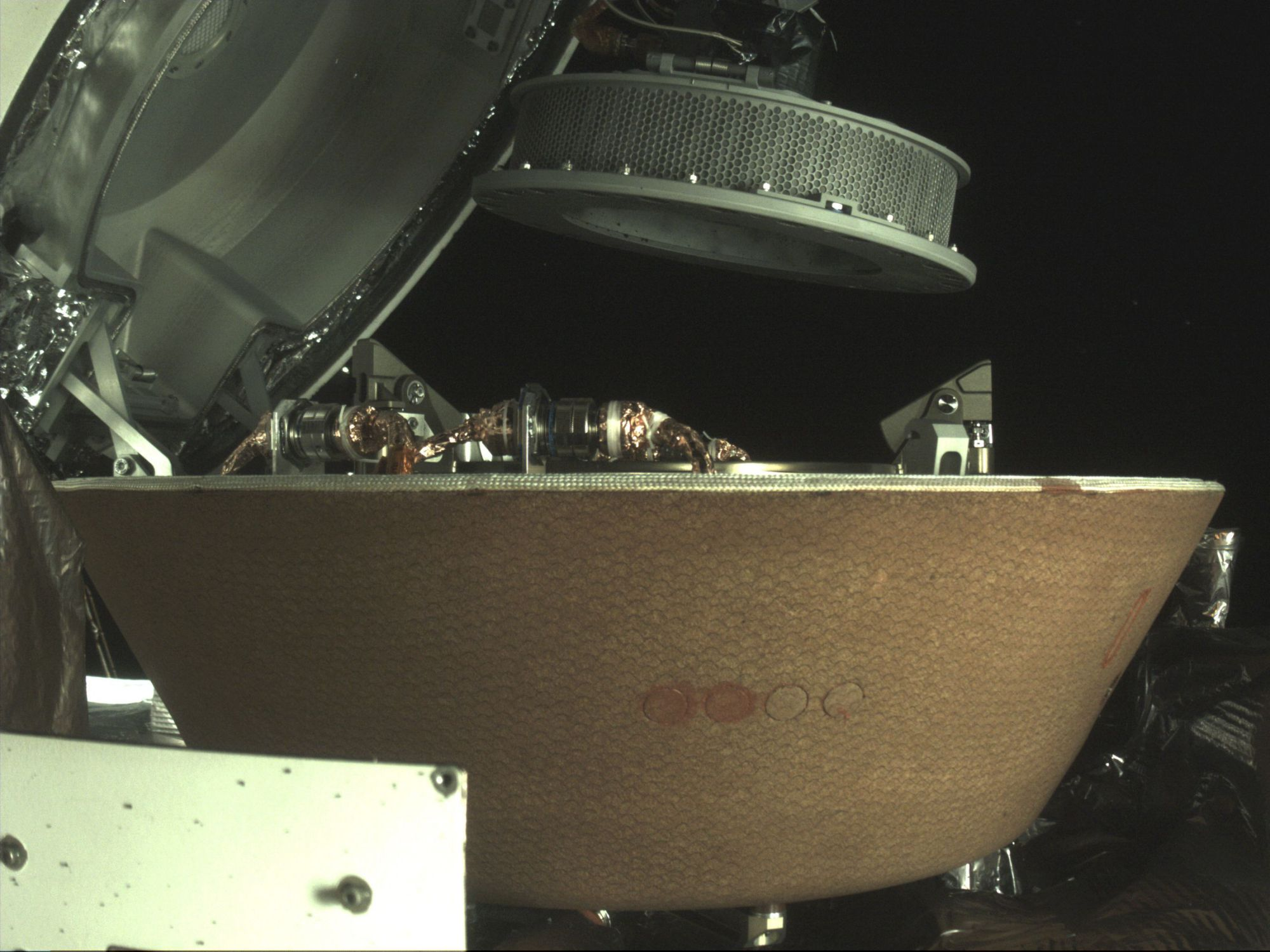 Asteroid specimens were embedded in the capsule to return to Earth