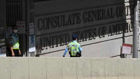 Security guards are seen outside the US consulate in Hong Kong on October 27, 2020.