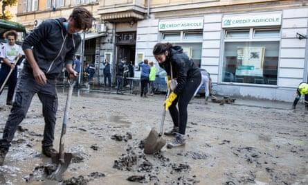People clean up after a flood in Ventimiglia, northern Italy