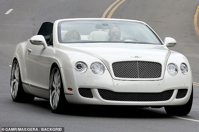 Ride in style: Following their meal, the A-List couple entered and exited in their white Bentley
