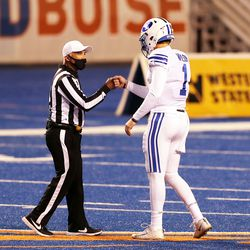 BYU Cookers Quarterback Sock Wilson (1) Fist-pumps with an officer before playing BYU and Boise State at the Albertson Stadium in Boise on Friday, November 6, 2020.