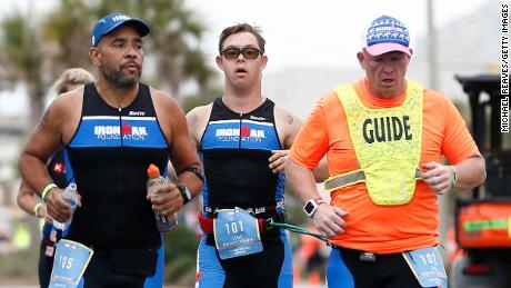 Chris Nick and his mentor Dan Creep compete in the Ironman Florida run.