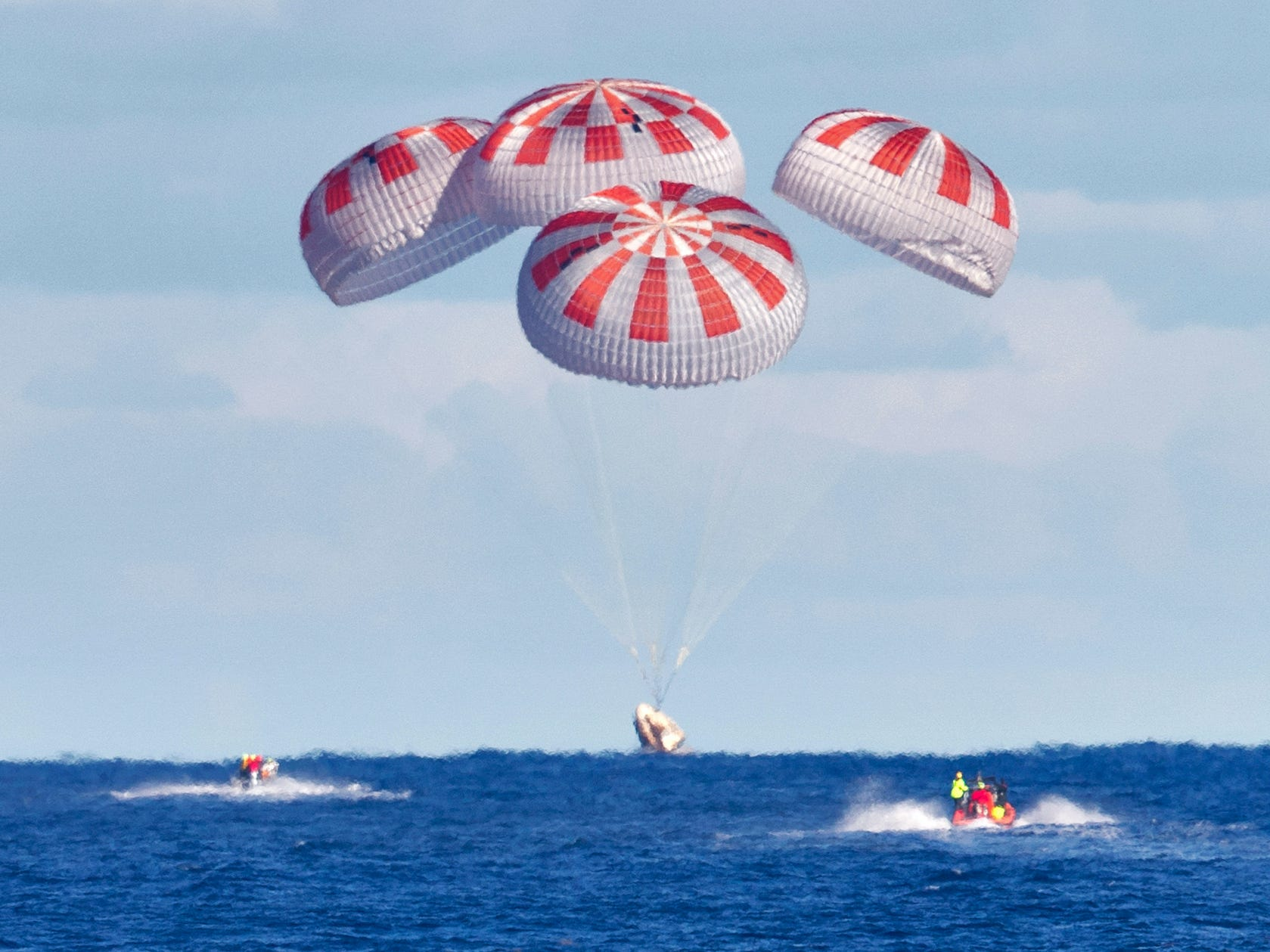 Space X Crew Dragon Spaceship Demo 1 Demo 1 Parachutes Splash Down Atlantic Ocean Cape Canaveral Florida NASA KSC 20190308 PH_CSH01_0192_orig