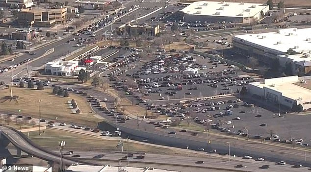 The huge lines leading to Aurora's in-n-out location and traffic are shown from the sky