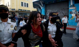 A protester was arrested during a clash between police and protesters in Guatemala City on Saturday.