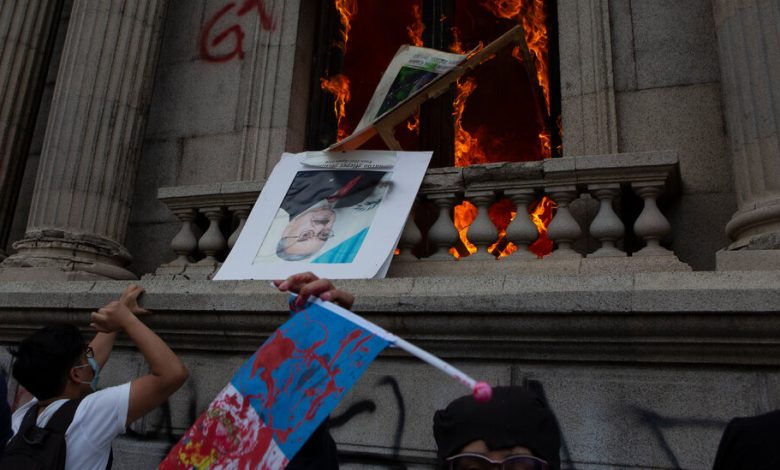 In Guatemala, protesters set fire to a congressional building to cut costs