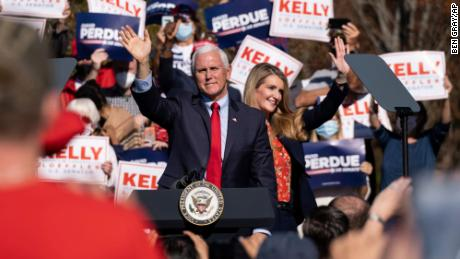 Vice President Mike Pence and Georgia Sen during a majority rally in Canton, Georgia on November 20, 2020.  Kelly Lofler wave to the crowd.