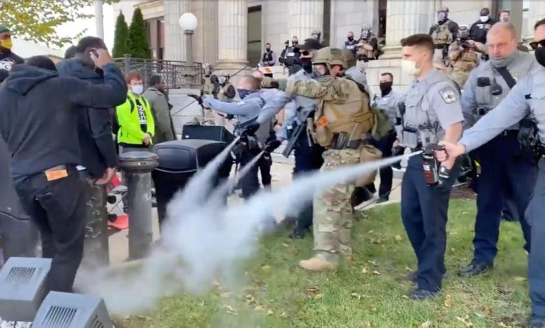 Police used pepper spray to break up a North Carolina march into a polling station