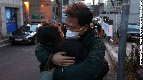 A father hugs his daughter during a college entrance exam on December 3, 2020 in Seoul, South Korea, amid a corona virus infection.