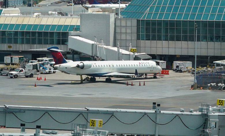 Couple Arrested After Fleeing Plane Via Emergency Slide With Pet Dog