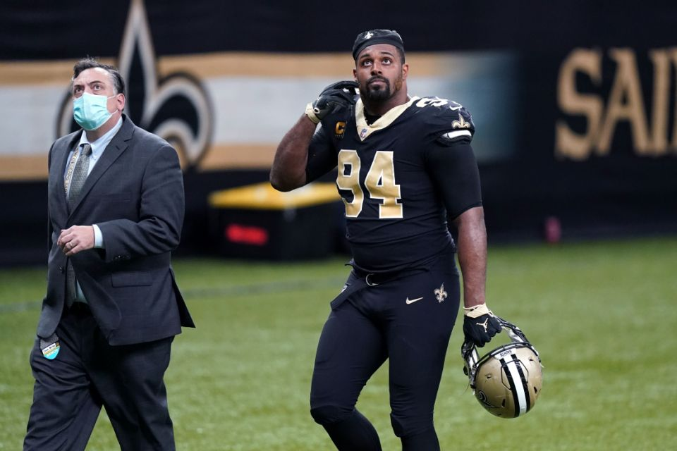 Cameroon Jordan (94), defensive end of the New Orleans Saints, left the field after being knocked out of the game in the second half of the NFL football game against the Kansas City Chiefs in New Orleans on Sunday, December 20, 2020.  (AP Photo / Butch til)