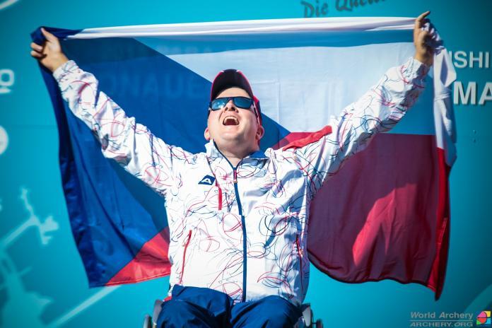 Archer hoists the flag