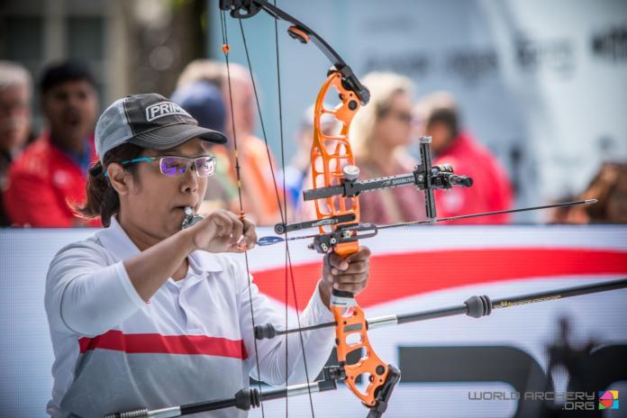 Senator Archer prepares the bow and arrow