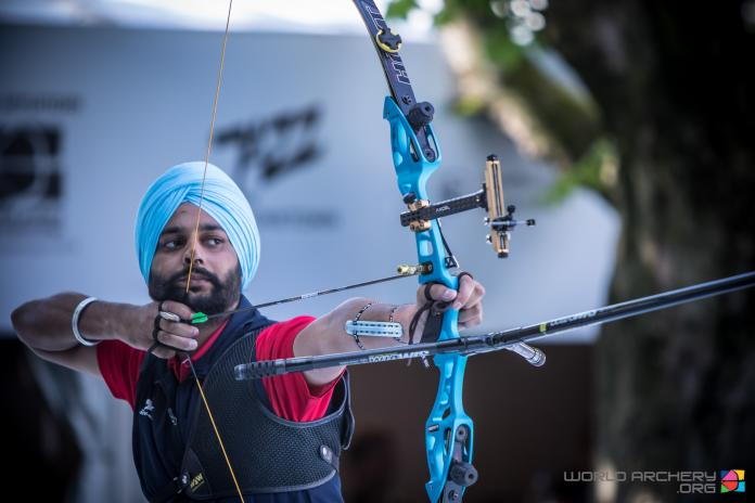 Indian archer shoots his bow