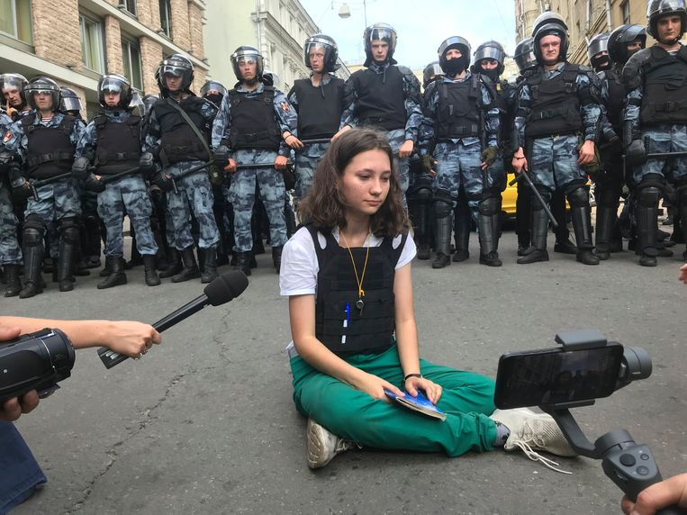 A student reading the constitution of Russian agents sentenced to two years in detention