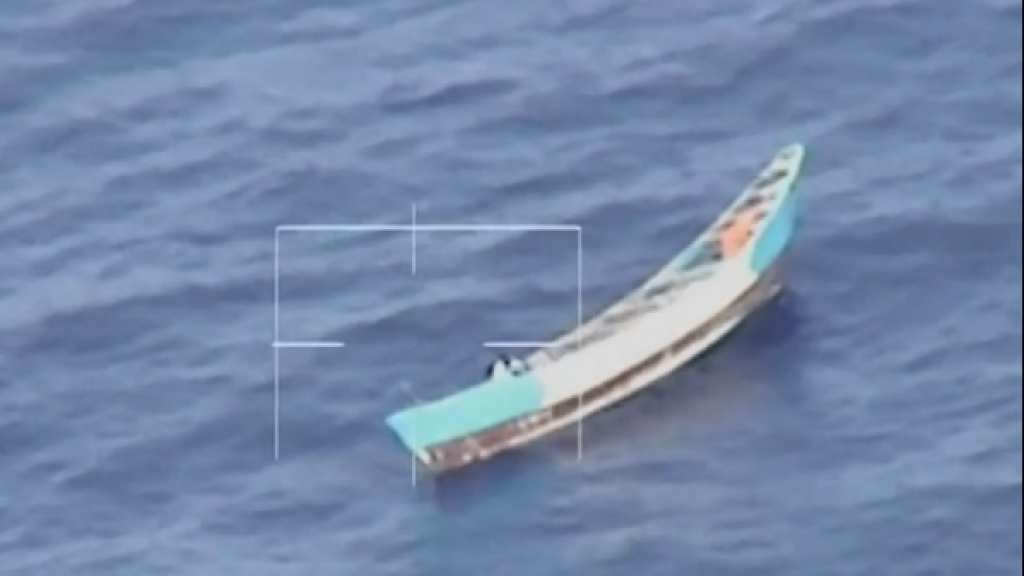 Girl (17) rescued from stranded boat, 56 others died: `` mass grave at sea ''