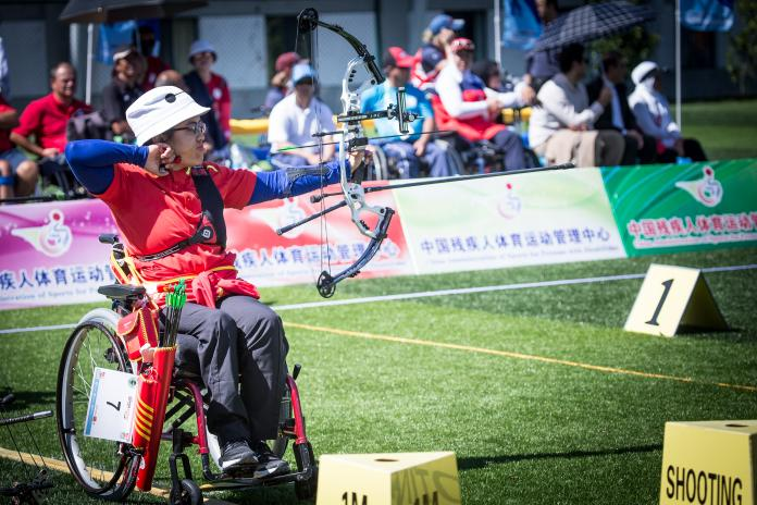 Archer necklaces in a wheelchair pull the bowstring