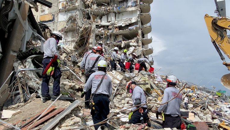 Rescue teams are working on the unstable cement and steel mounds in hopes of finding survivors.  Image via REUTERS