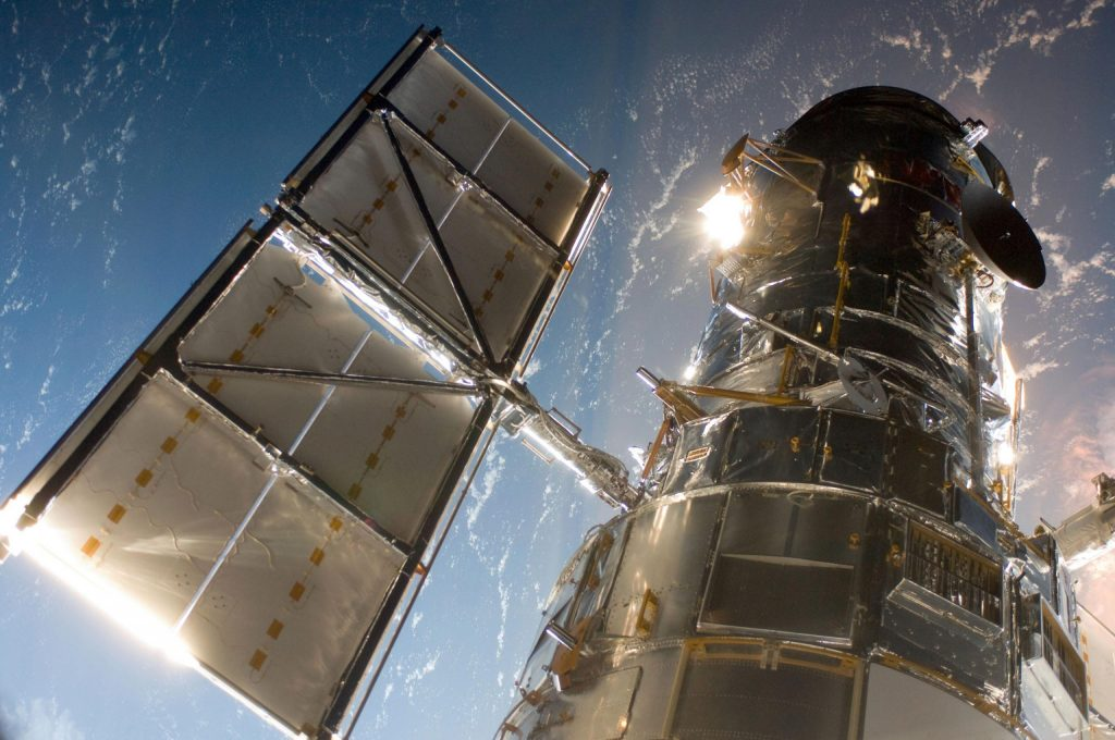 NASA struggles to fix the Hubble Space Telescope computer malfunction in the 1980s