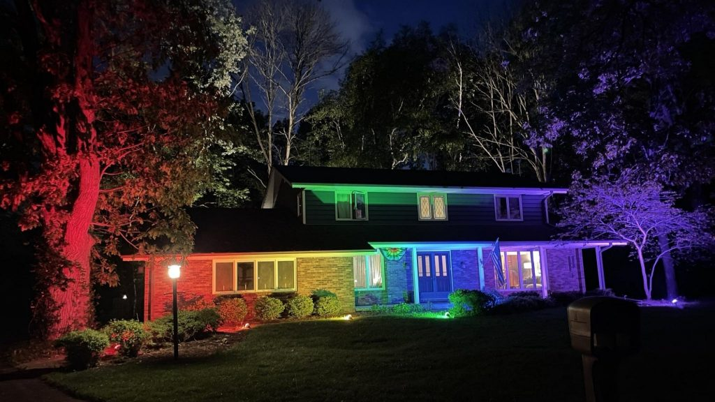 The flag can't get out, so this couple lights up the entire US house in the colors of the rainbow
