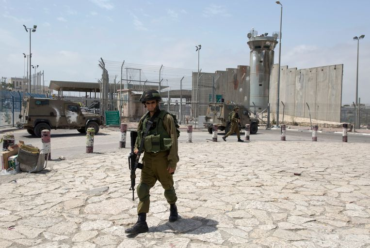 An Israeli soldier at the Kalandya checkpoint, a major border crossing between Israel and the West Bank.  AP Image