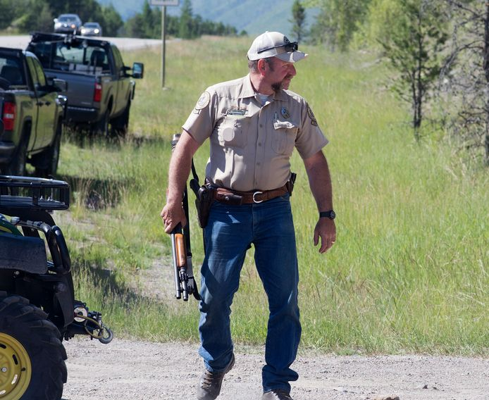 An FWP game warden hunting a grizzly bear that killed a ranger in late June 2016. The victim was cycling out of service on a popular trail system near West Glacier when the bear attacked him.