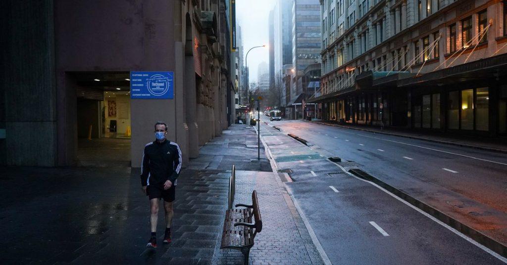 Australia halves overseas arrivals, offers roadmap to exit COVID-19