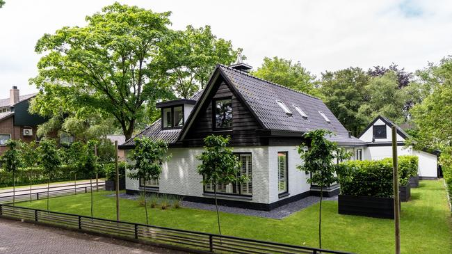 For sale in Drenthe: Modernized detached luxury villa with a large private garden