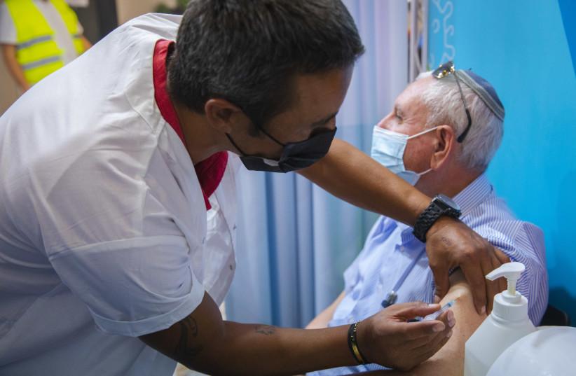 Israel's COVID-19 vaccine recalls show signs of taming a delta