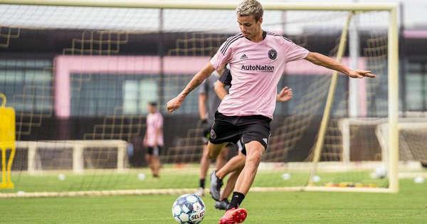 Romeo Beckham (19) in soccer (ball) follows father David